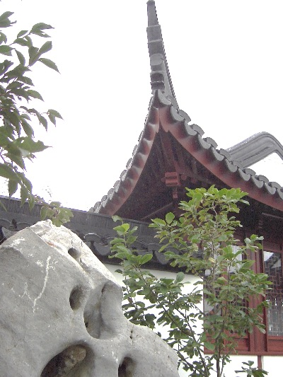 "Roof curvature of the side pavilion to the main hall, in the Dunedin Chinese Garden  "" Lan Yuan."""