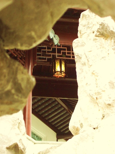 "In a different light - the scene - looking through a Taihu rock on the Northern side of the Climbing Mountain half Pavilion, in the Dunedin Chinese Garden  "" Lan Yuan."""