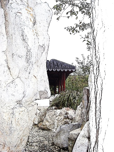"Whether we are looking out of a mountain grotto - or into one - like this one in the Dunedin Chinese Garden "" Lan Yuan."""