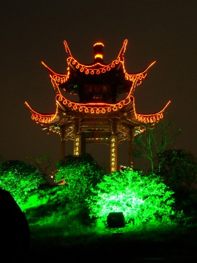 A pavilion is lit up above the wonderful lush foliage, of Yangzhou.