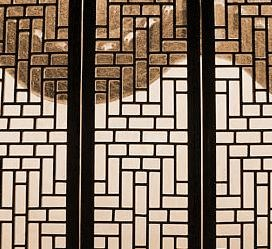 Searching through the lattice window in a Chinese garden pavilion.