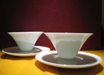 "White ceramic tea cups from  "" One Tea House - Siang Ming Tea Shop."""