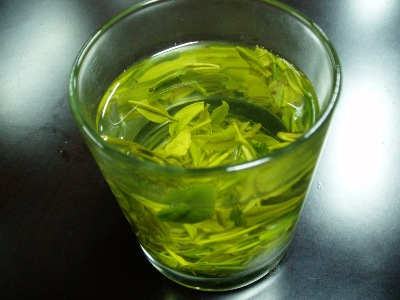 A glass of freshly made Green tea.