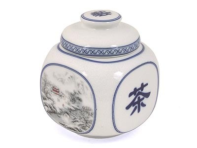 A porcelain Chinese Tea container, with the Chinese character for tea on one side.