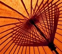 Some prefer the protection of a Chinese umbrella.